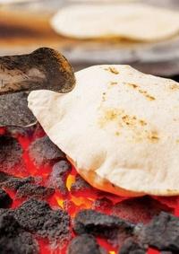 تلوث الهواء من الطهي على الفحم والخشب يضر عقول المواليد