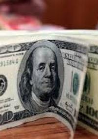 الدولار والدينار يواصلان الانخفاض