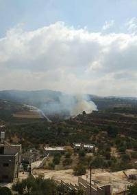 مستوطنون يضرمون النار بحقول زراعية جنوب غرب نابلس